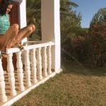 Brunette girl piss from railing