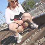 Brittany Blaze   Public Pissing on Railroad Tracks.