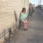 Linda  is forced to piss in an alley.