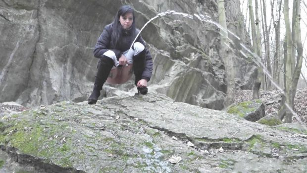 With you Girl peeing on a rock