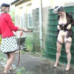 Charming Dressed Lesbians Outdoor Piss.