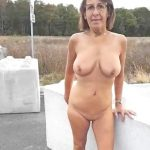 Naked Milf peeing on the road.