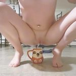 Little Rose pisses into Daddy's favorite mug. Manyvids.