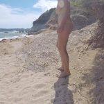 Juicy July – Girl pissing on public beach.