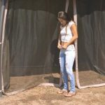 Lexi Dona – Setting up a tent  and wets in her jeans.